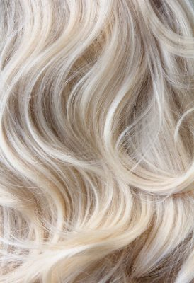 Female blonde curly  hair texture